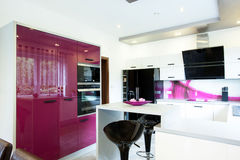 Modern kitchen with purple elements. View of modern kitchen with purple elements Stock Image