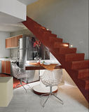 Modern kitchen with red staircase Royalty Free Stock Photo