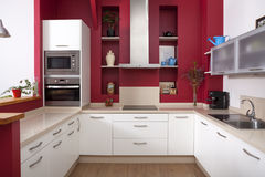 Modern kitchen with red walls Royalty Free Stock Image