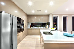A modern kitchen with refrigerator and fixed to the wall with ca Stock Photo