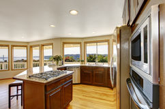 Modern kitchen room interior with many windows and perfect view. Stock Photography