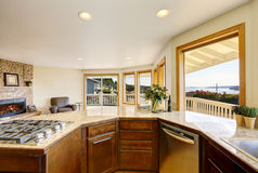 Modern kitchen room interior with many windows and perfect view. Stock Photo
