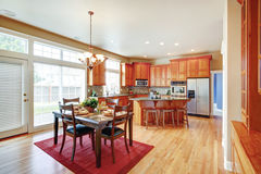 Modern kitchen room with island and dining area Stock Images