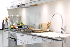 Modern kitchen room with kitchenware and utensil on counter Stock Image