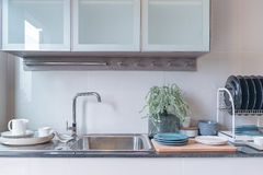 Modern kitchen room with sink on top granite counter Stock Image