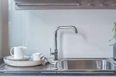 Modern kitchen room with sink on top granite counter Royalty Free Stock Photography