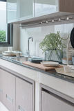 Modern kitchen room with sink on top granite counter Stock Photo