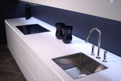 Modern kitchen sink. Modern kitchen with special light and design sink royalty free stock photo