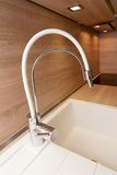 Modern kitchen sink and faucet Royalty Free Stock Photos