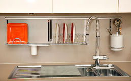 Kitchen sink. Modern kitchen sink with a few dishes, accessories and utensils royalty free stock photos