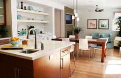 Modern kitchen with sitting and dining area Royalty Free Stock Photos