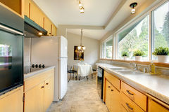 Modern kitchen with a small dining area Royalty Free Stock Image