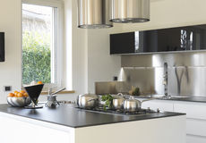 Modern kitchen with steel pans Stock Images