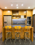 Modern Kitchen. Stylish modern contemporary kitchen with island bar, chair and home appliances Stock Photos
