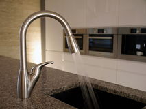 Modern kitchen tap Stock Photography