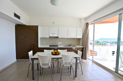Modern kitchen. View of a modern kitchen and dining table Royalty Free Stock Photography