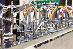 Modern kitchen water faucets in store. Modern kitchen water faucets in the store Royalty Free Stock Photos