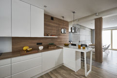Modern kitchen  with white and brown walls Stock Photos