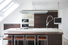 Modern kitchen. White counter in modern kitchen Royalty Free Stock Images