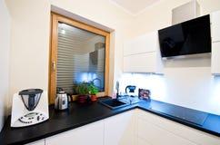 Modern kitchen in white. White furniture kitchen interior in modern style, elegant home design Stock Image