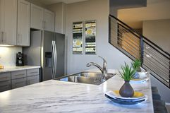 Modern Kitchen in White. Modern high end luxury kitchen in new construction home with a marble island Stock Images
