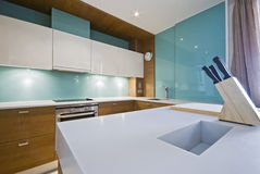 Modern kitchen with white worktop. Modern designer kitche with separate work area and white worktop Royalty Free Stock Photography