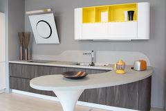 Modern kitchen white and yellow Royalty Free Stock Image