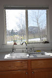 Modern kitchen window and cabinets Royalty Free Stock Photography