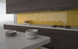 Modern kitchen with yellow splash back Stock Photo
