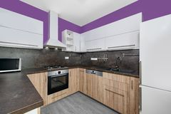 Kitchen. Modern kitchens combined with white and purple color and oak wood Stock Photos