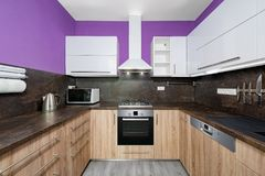 Kitchen. Modern kitchens combined with white and purple color and oak wood Royalty Free Stock Photos