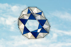 Modern kite flying in blue sky Royalty Free Stock Image
