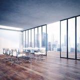 Modern kontorsinre med cityscape Arkivfoto