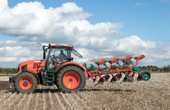 Modern Kubota tractor pulling a plough Stock Images