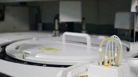 Modern laboratory machine automatically checks blood samples at hospital. Laboratory equipment, immunoassay and clinical. Chemistry analyzer, chemical pathology stock video footage