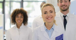 In Modern Laboratory Successful医生研究员小组混合种族科学家愉快的微笑的队  股票视频
