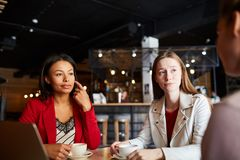 Modern ladies meeting in cafe royalty free stock photos