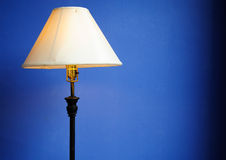 Modern lamp in a blue wall. At home Royalty Free Stock Photography