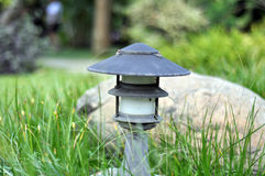Modern lamp in garden. Outdoor light. Decorative garden lamp for landscape lighting Royalty Free Stock Photo