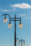 Modern Lamp post in the sky. Royalty Free Stock Photography