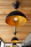 Modern lamp on wooden ceiling. A modern lamp on wooden ceiling Royalty Free Stock Photos