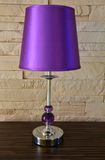 Modern lamp on wooden table. Purple modern lamp on wooden table Stock Image