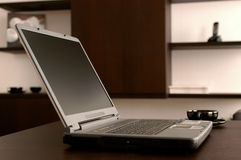 The modern laptop. On a dark table Stock Photography