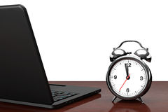 Modern Laptop with Alarm Clock Stock Images