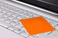 Modern laptop with blank card on it Stock Image