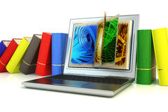 Modern laptop between books Stock Photos