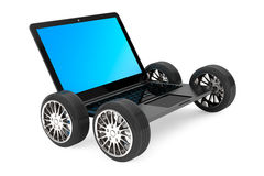 Modern laptop with car wheels Royalty Free Stock Images