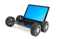 Modern laptop with car wheels Royalty Free Stock Photos