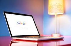 Modern laptop closeup on red modern desk Royalty Free Stock Photos