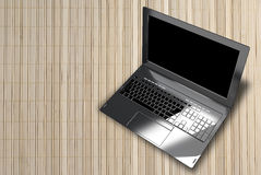 Modern laptop closeup on wooden abstract light background Royalty Free Stock Photo